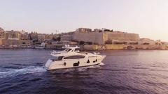 Drone Footage Of Yacht Moving Towards Shore Sea Malta Harbor Mediterranean Sky Stock Footage