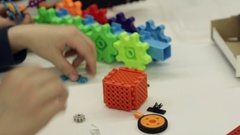 Child's hands playing with colorful plastic bricks at the table. Stock Footage