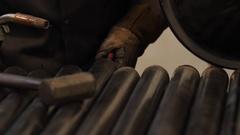Welder working in machine shop Stock Footage