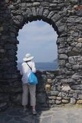 Round arch on ruined medieval walls. Stock Photos