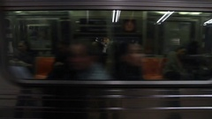 Subway train passing in front of camera Stock Footage
