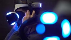 VR games. Teens use virtual reality helmets, racing simulator. Stock Footage
