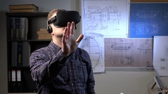 Man uses a virtual reality glasses in the office. Stock Footage