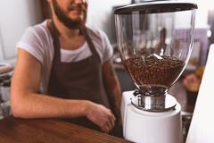 Man standing near the coffee apparatus Stock Photos