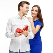 Happy young couple with Valentine's Day present Stock Photos