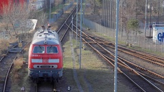 Parked Deutsche Bahn locomotive on railroad train tracks, Berlin, Germany Stock Footage