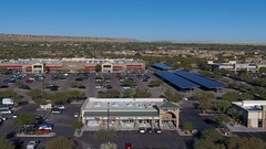 Aerial view of Walmart store and strip malls Stock Footage