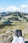 Legs  of hiker woman sitting in the top  mountain  Stock Photos