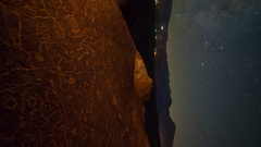 Astro Timelapse of Milky Way over Native American Rock Art -Vertical/Tilt Up- Stock Footage