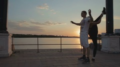 Girl and men dancing strip plastic at sunset stock footage video Stock Footage