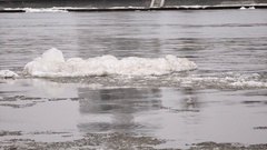 Grey river with a big block of ice Stock Footage
