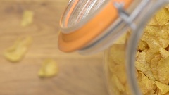 Cornflakes in a glass jar. Breakfast food film clip from above. Stock Footage