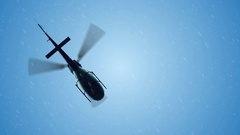 Helicopter flying in the blue sky. Winter snowfall Stock Footage