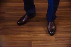 Business man dressing up with classic, elegant shoes. Groom wearing on wedding Stock Photos