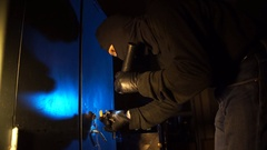 The criminal thief opens the safe in the dark night Stock Footage