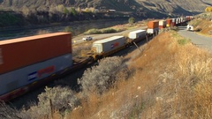 Railroad container train north side of river wide shot, good length Stock Footage