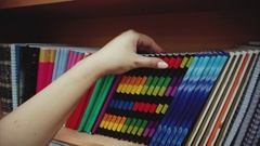 Woman hand choosing notebook in the stationery shop Stock Footage