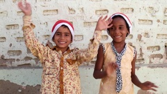 MS Brother sister with Santa hats singing and waving hands Stock Footage