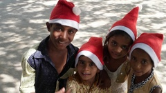 Top shot of kids with Santa hats point to the camera Stock Footage