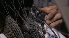 Bike mechanic making adjustments to the disc brakes of a mountain bike CU Arkistovideo
