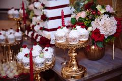 Candy bar, red colour, marsala. Table with wedding cake, sweets, candies Stock Photos