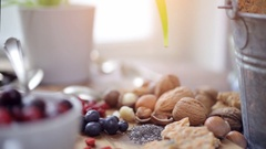 Superfoods collection, variation of healthy superfoods on wooden background Stock Footage