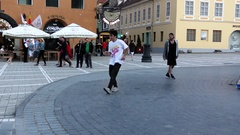 BRASOV – ROMANIA: People dance breakdance in the old city center Stock Footage
