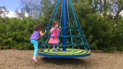 Time lapse young girls play on a carousel Stock Footage