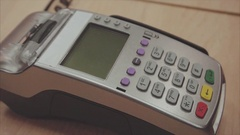Woman's hand swipe credit card payment on pos terminal and push the buttons Stock Footage