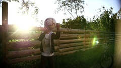 Boy dreams of becoming a soccer player throws the ball up outdoors Stock Footage