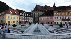 BRASOV, TRANSYLVANIA, ROMANIA. People relax in the old city center Stock Footage