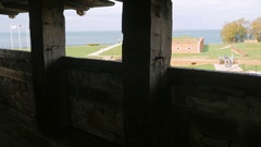 Silhouette of an old cannon at Fort Niagara. Its trunk looks at trees. Side view Stock Footage