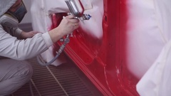 Man paints car in the garage Stock Footage