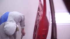 Repair and painting of vehicles in workshop Stock Footage