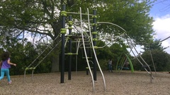 Young girl play in the playground Stock Footage