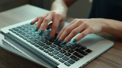 Woman on the MacBook keyboard Stock Footage
