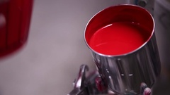 Red paint for car painting Stock Footage