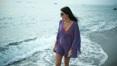 Beautiful romantic woman walking on the beach in summer vacation. Stock Footage