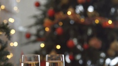 Champagne. Two Flutes with Sparkling Champagne over Holiday Bokeh Blinking Stock Footage