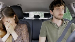 Woman crying while boyfriend is angry driving car Stock Footage
