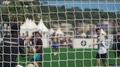 Active men playing soccer outdoors, view through net, healthy lifestyle, leisure 4k or 4k+ Resolution