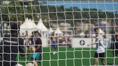 Active men playing soccer outdoors, view through net, healthy lifestyle, leisure Stock Footage