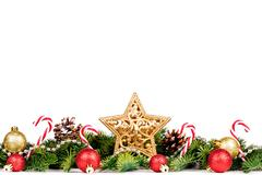 Christmas Border - tree branches with golden balls, candy and big star isolated Stock Photos