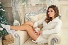 Attractive model in beautiful living-room Stock Photos