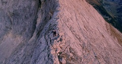 Drone Footage Of Man Climbing On Top Of Mountain Hiking Adventure Sunset Nature Stock Footage