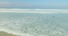 Group of Surfers Catching Waves Stock Footage