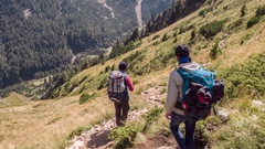 Men Carrying Backpacks While Hiking In Mountain Adventure Extreme Sport Healthy Stock Footage