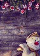 Christmas background with branches of spruce and snowman textile Stock Photos