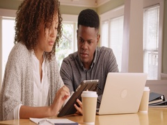 Young black millennials working at a home business Stock Footage