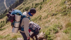 Male Backpackers Hiking In Mountain Path Walking Adventure Healthy Lifestyle Stock Footage